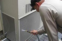 a refrigeration mechanic performs preventive maintenance on an HVAC unit