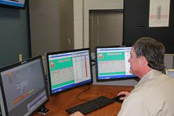 FOM team member monitoring alarms on lcd displays