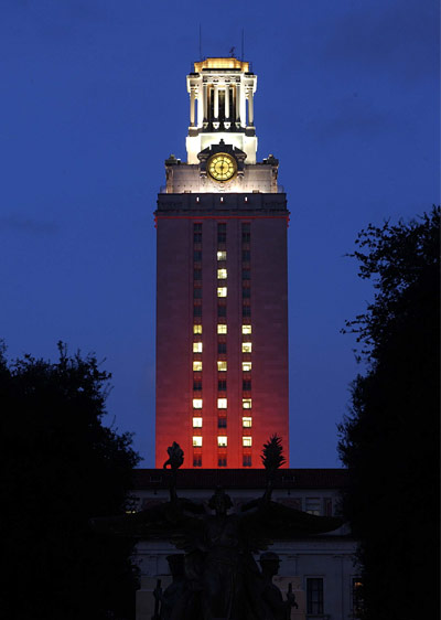 UT tower lit up at dusk during the blue hour