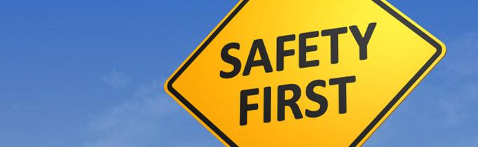 safety sign against blue sky