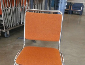Padded non-folding orange chair