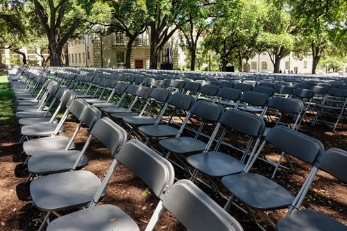 Seats set up for graduation on southlawn during a beautiful sunny day